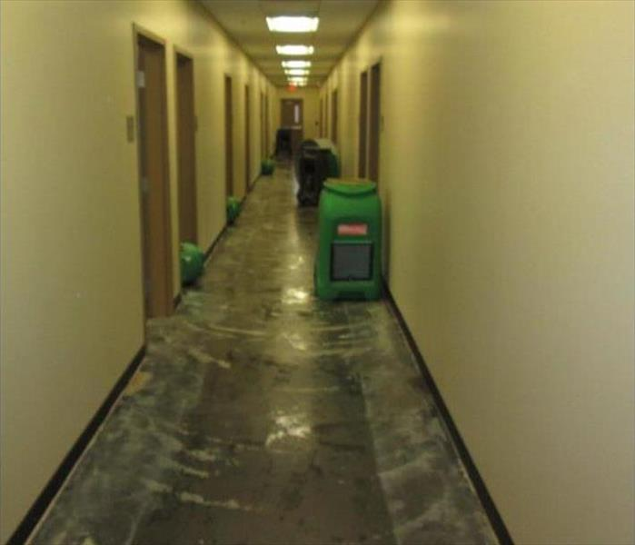 water and carpet removed from corridor, drying equipment in place