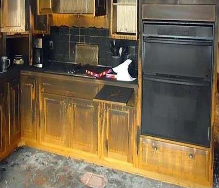 fire damaged kitchen covered in soot