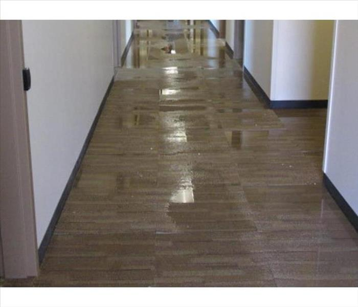 hotel corridor flooded with water