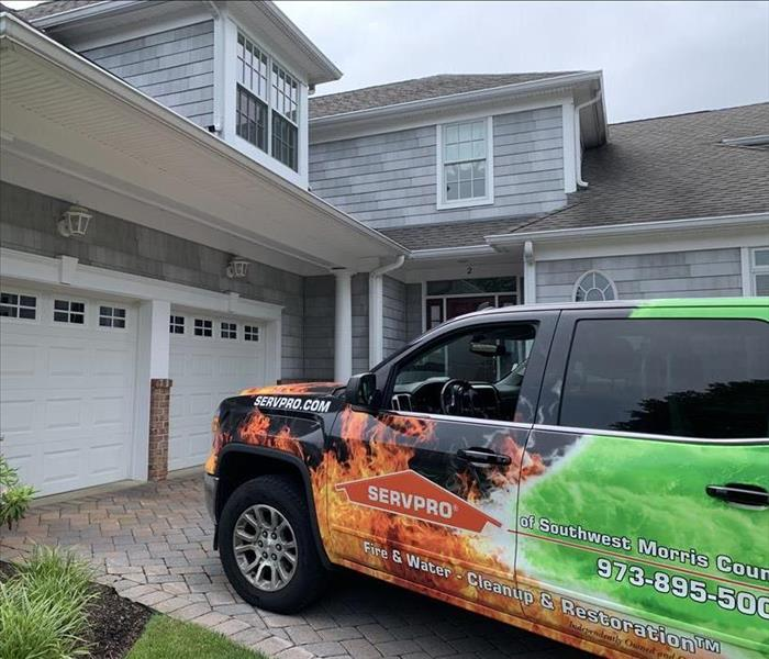 SERVPRO SUV Wrapped in Logo Design Parked in Client Driveway