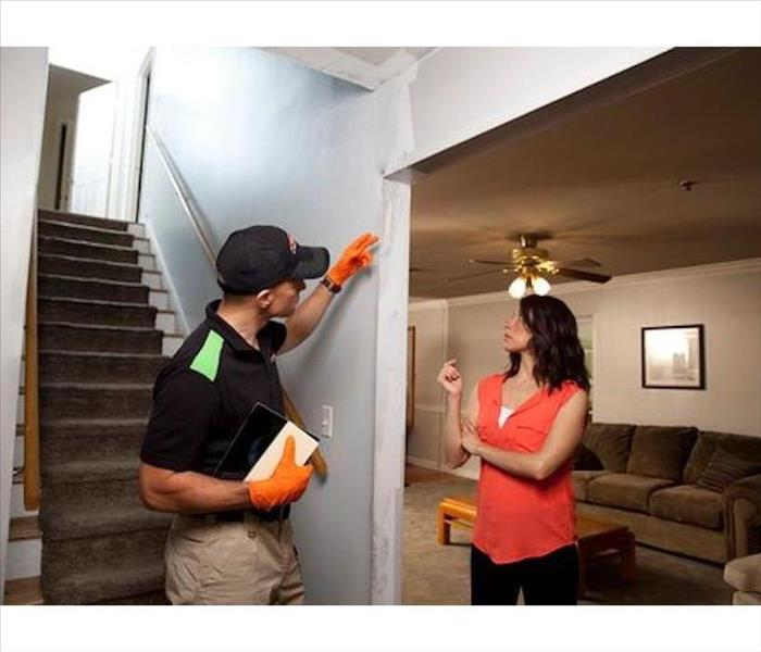 SERVPRO Tech. talking to home owner