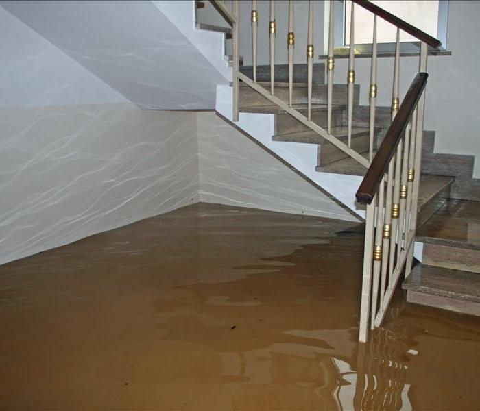 an area of the house with stairs that is flooded